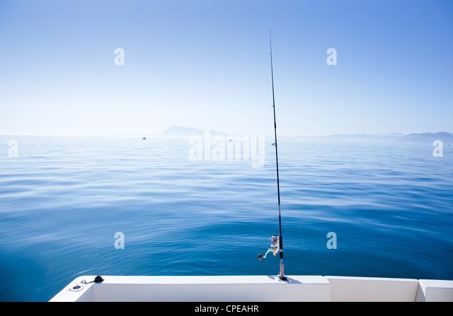 boat fishing rod in mediterranean blue sea in Spain - Stock Image