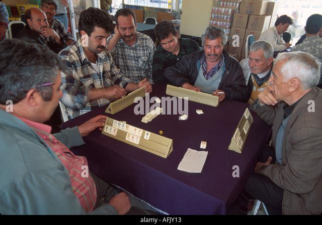 Turkey Selcuk men play game called okey tash - Stock Image