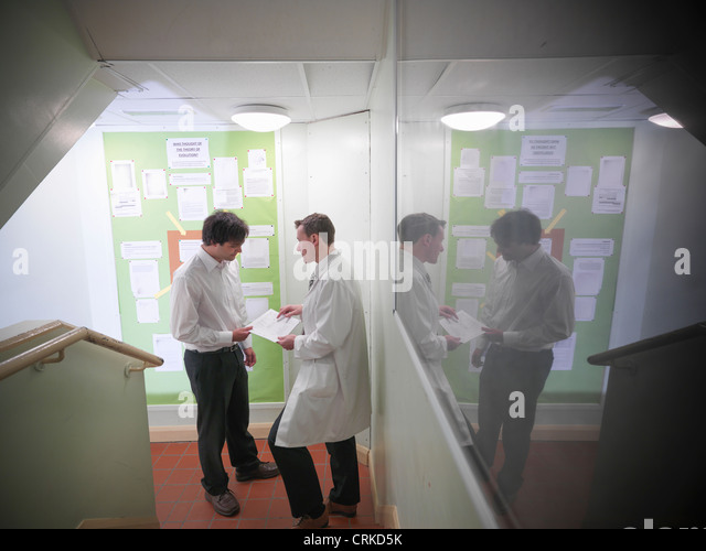 Science teacher talking to student - Stock Image