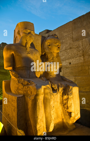 Luxor Temple Egypt night illuminated defaced statues of royalty popular Egyptian tourist attraction - Stock Image