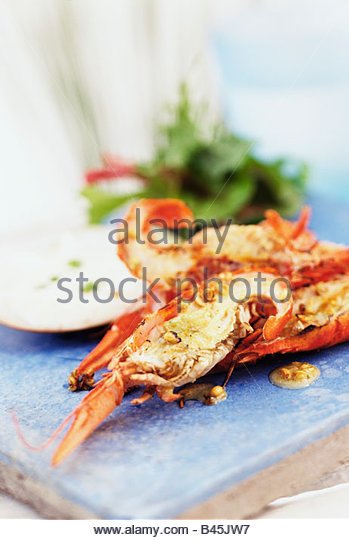 Barbecued yabbies (Australian freshwater crayfish) with dip (1) - Stock Image