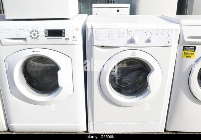 wall of washing machines outside consumer appliance shop - Stock Image