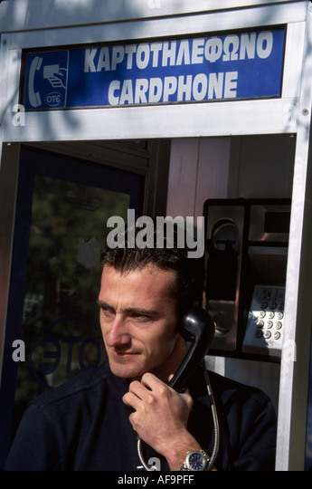 Greece Olympia man resident public pay phone - Stock Image