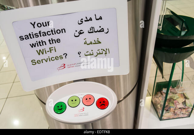 wi-fi service feedback via touch button input at Bahrain International Airport, Bahrain, Middle East, - Stock Image