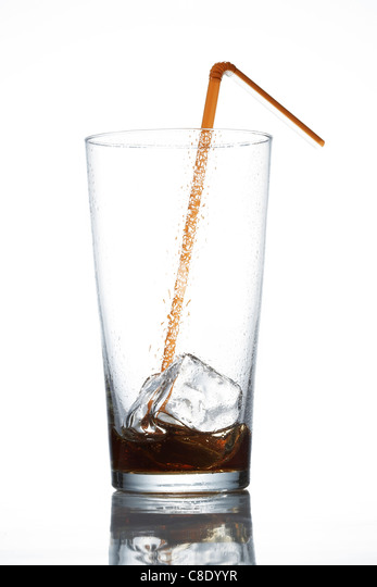 Empty glass of cola with straw - Stock Image