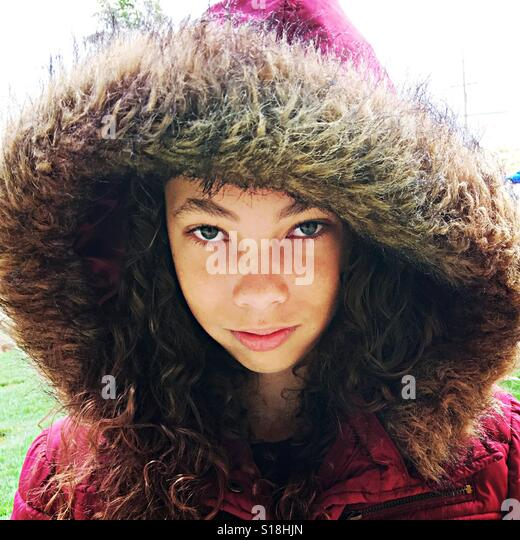 Girl with hood. - Stock-Bilder