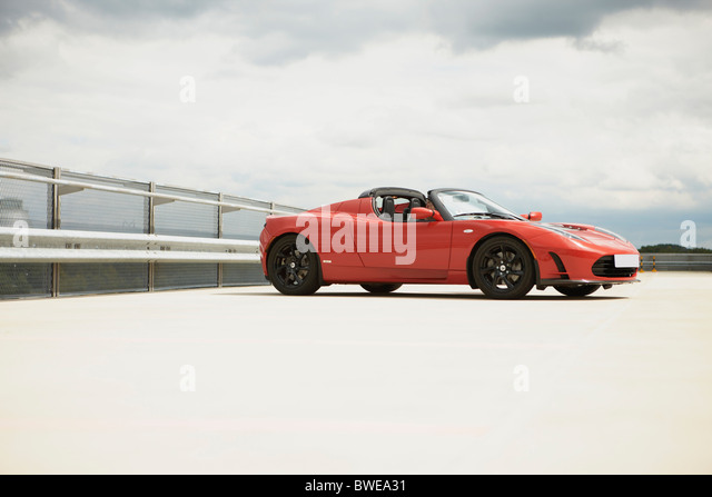 Electric car on parkdeck - Stock Image
