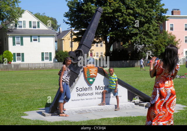 Massachusetts Salem Salem Maritime National Historic Site National Park Service logo anchor Black girl boy sister - Stock Image