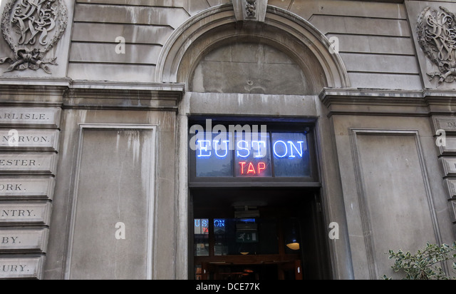 The Euston Tap bar at Euston Station London - Stock Image