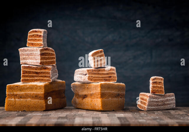 Pyramids of pastila pieces on the wooden table - Stock Image