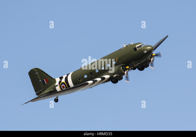 The RAF Battle of Britain Memorial Flights Douglas C-47 Skytrain banking over Elizabeth Castle, Jersey, Channel - Stock Image
