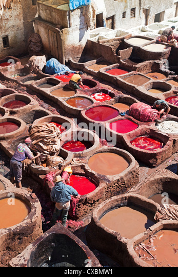 Vats for tanning and dyeing animal hides and skins, Chouwara traditional leather tannery in Old Fez, Fez, Morocco, - Stock Image