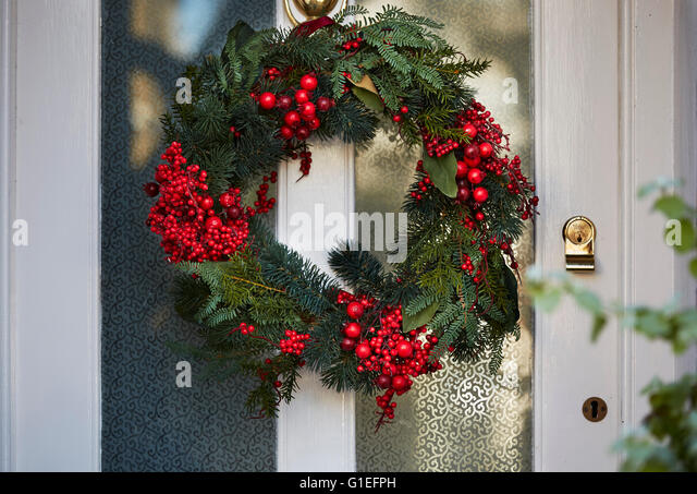 Christmas Garland on Door. - Stock Image