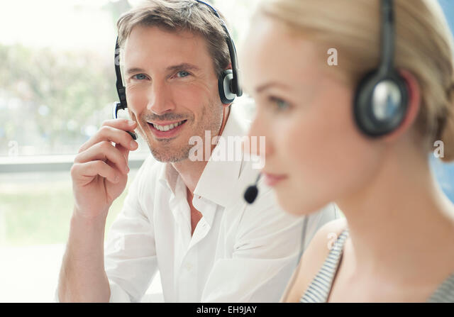Professionals working in call center - Stock Image
