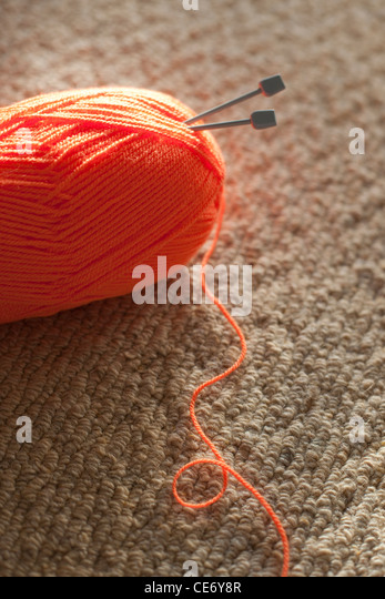 Ball of orange wool - Stock Image