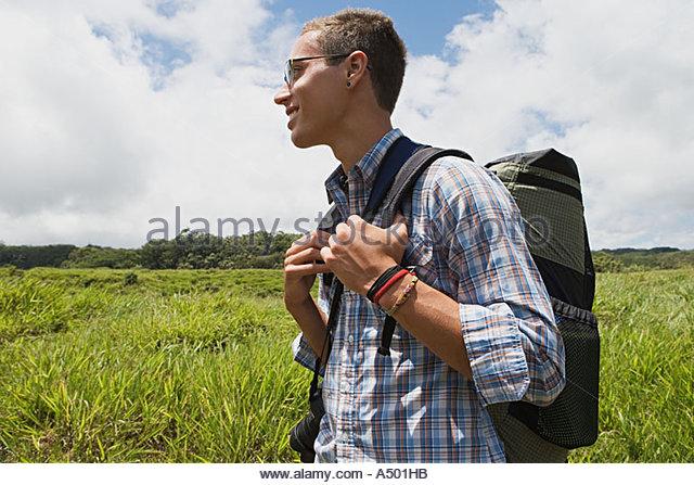 Young man on trek - Stock Image
