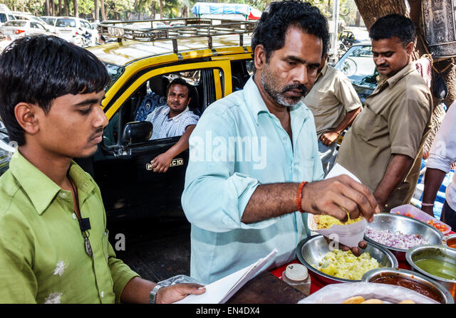 India Asian Mumbai Fort Mumbai Veer Nariman Road street food vendor man sale - Stock Image