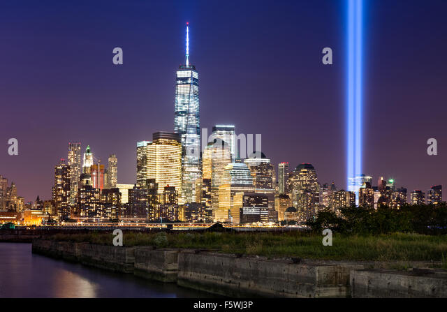 Tribute in Light, two vertical columns of light rise above Lower Manhattan adjacent to the new World Trade Center, - Stock Image