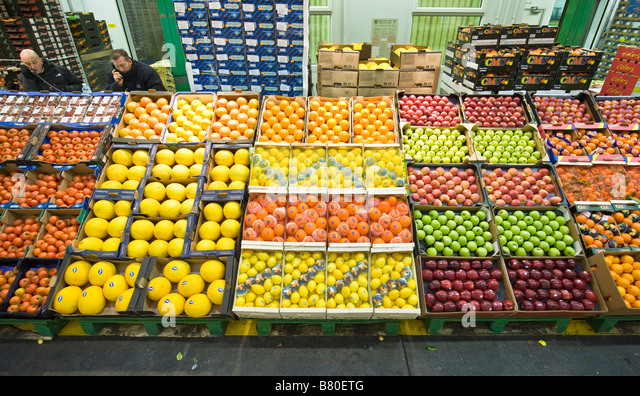 large display of fruits at New Covent Garden Fruit and Vegetables wholesale Market London UK - Stock Image