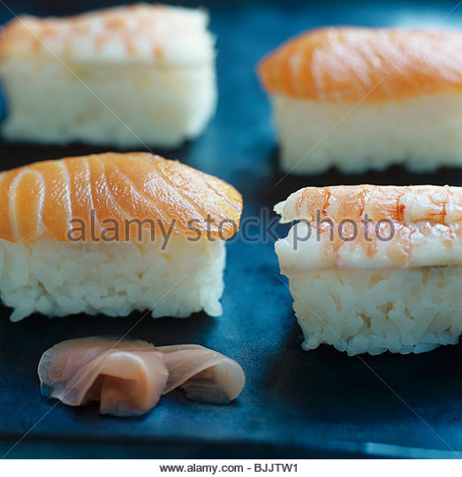 Four nigiri sushi with salmon and prawns - Stock Image