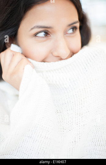 MODEL RELEASED Portrait of a woman wearing white jumper. - Stock Image