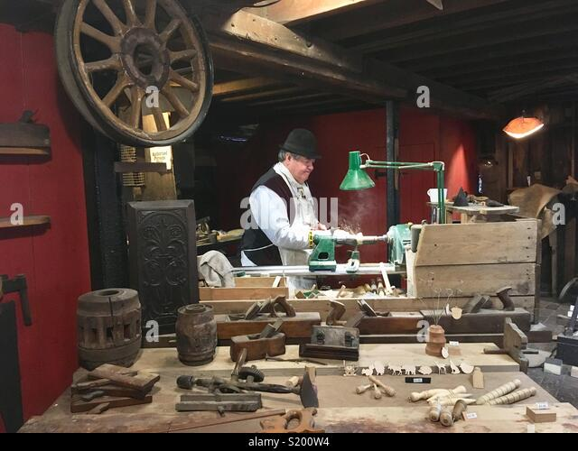 Traditional carpenter, working at the lathe, Blists Hill, Shropshire, England - Stock Image