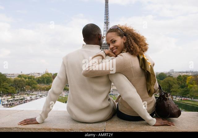 Rear view of African couple hugging - Stock-Bilder