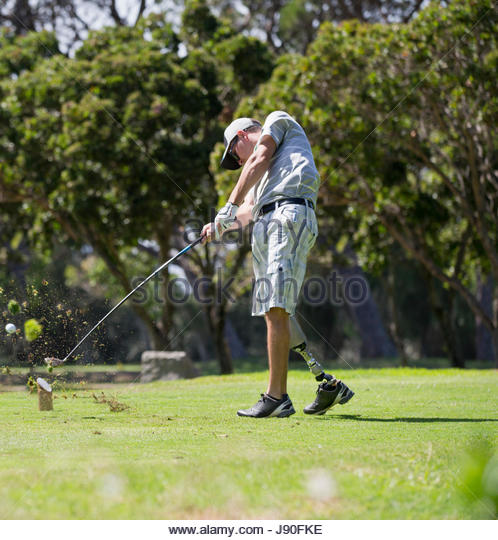 Male Golfer With Artificial Leg Teeing Off On Golf Course - Stock-Bilder