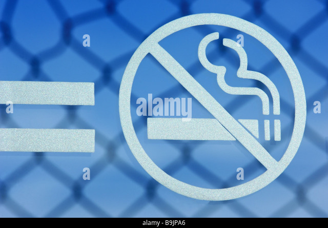 Sign signs smoke-prohibition stitch-wire-fence - Stock Image