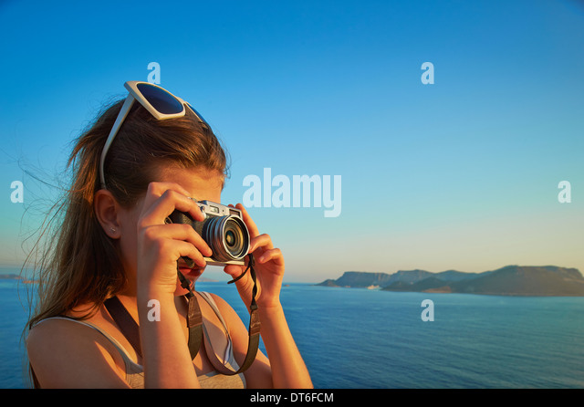 Girl taking photographs on holiday, Kas, Turkey - Stock Image