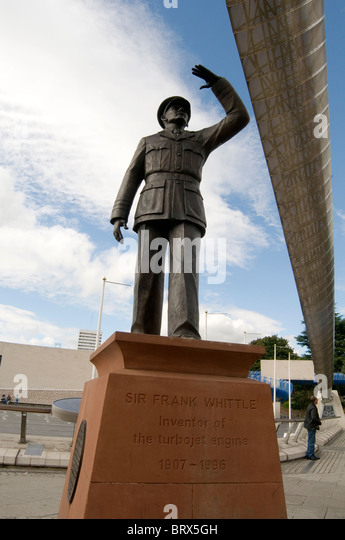 frank whittle inventor of the jet engine statue statues in coventry uk brass outside motor museum in town centre - Stock Image