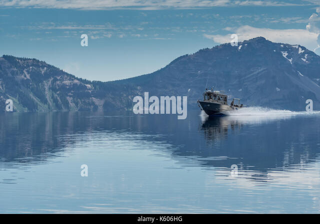 Research Boat Cruises Across Crater Lake near lake access - Stock Image
