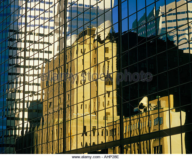 Reflections in office towers on University Street in Montreal Quebec Canada - Stock Image
