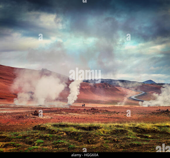 Steaming fumarole in geothermal valley Hverarond, located near Reykjahlid village in north of Iceland, Europe. - Stock Image