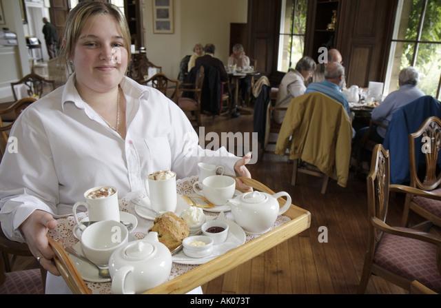 England UK Longhoughton Howick Hall Gardens 1782 Earl Grey Tea House waitress scones tray - Stock Image