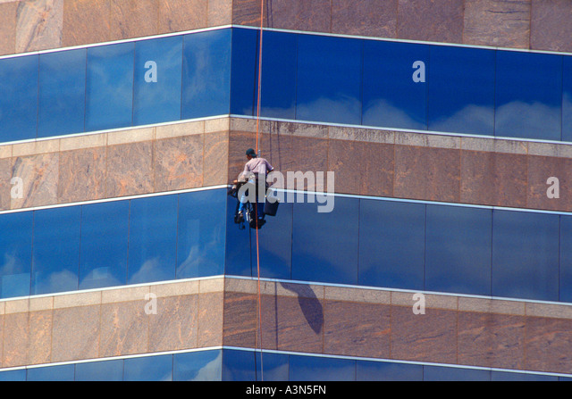 Window cleaners cleaning cleaning stock photos window for Window washing austin