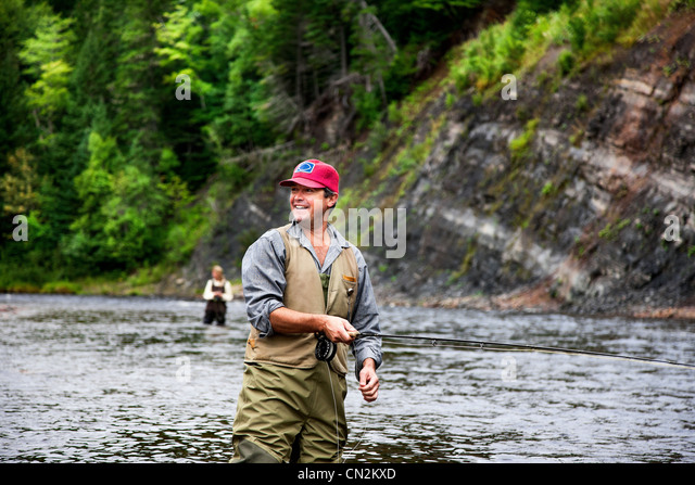 Fly fishers in Margaree River, Cape Breton Island, Nova Scotia - Stock Image