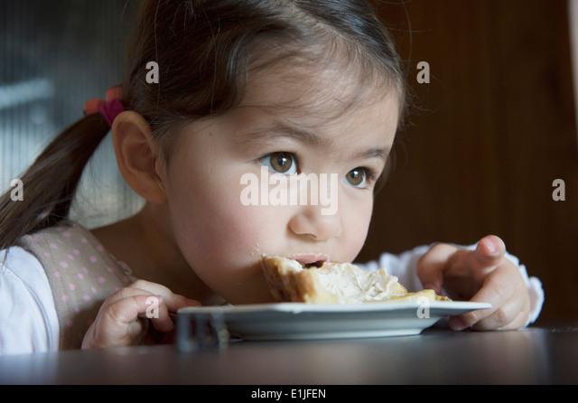 Girl finishing her tart - Stock-Bilder
