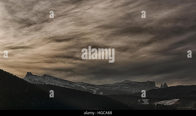 pastel colors at sunset over the Alpe di Siusi on a freezing January afternoon - Stock Image