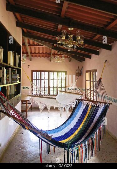 Woven rope hammocks terrace in vacation villa in Cerro Azul, Panama. - Stock Image