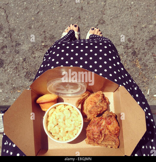 Woman with a Fried chicken take away - Stock-Bilder
