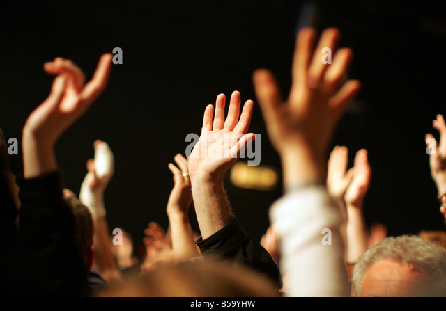 Fans raising their hands during a concert - Stock Image