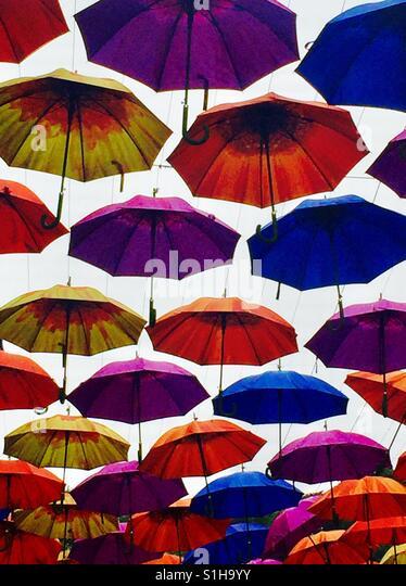 Umbrellas multicoloured suspended above  outdoor arcades in Bath Spa - Stock-Bilder