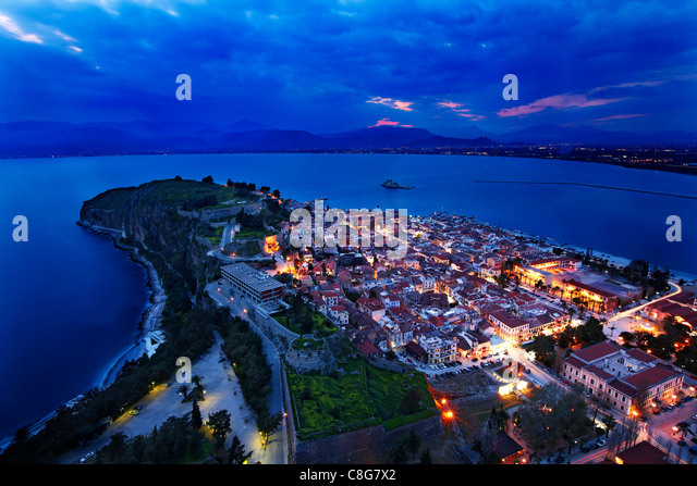 Panoramic view of Nafplio town and the Argolic gulf from Palamidi Castle, in the 'blue' hour. Peloponnese, - Stock Image