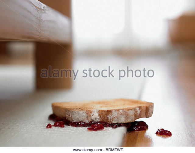 Toast and jam upside-down on carpet - Stock Image