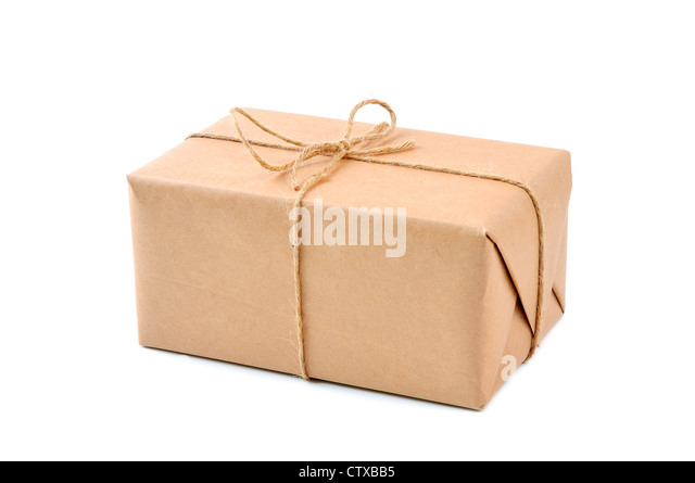 Cardboard carton wrapped with brown paper and tied with cord - Stock Image