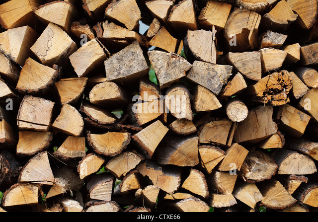 Stacked chopped wood for the winter or construction - Stock Image