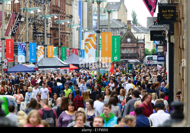 A busy Buchanan Street in Glasgow city centre with Glasgow 2014 Commonwealth Games banners, Scotland, UK - Stock Image