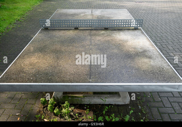 Outside table tennis court in the playground of a high school, Leichlingen, Germany. - Stock Image