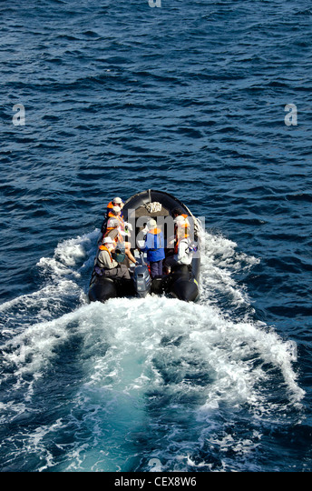 Zodiac inflatable boat leaving tour ship in the Galapagos Islands, Ecuador - Stock Image